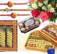 3 rakhi, kaju katli 1/2 kg, 16 ferrero chocolate, 1/2 kg dry fruit and 12 flowers bouquet