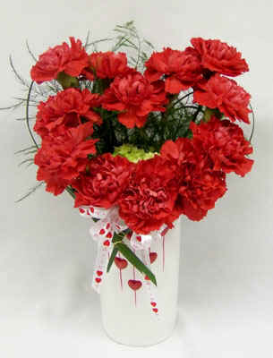 12 carnations in a vase