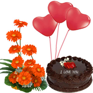 1 Pound Cake 3 Balloons And 12 Gerberas Hand Bouquet